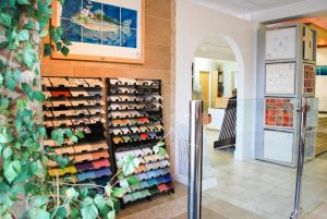 Our showroom with Noreen's popular Trout panel on the wall