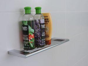 We preferred this beautiful shelf to shower baskets