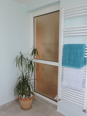 The balcony door became a fixed window to provide light to the landing