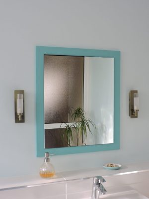 To make a mirror the right size and shape, we painted ply in the darker accent colour